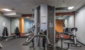 Fitness center features cardio equipment and free weights  Residences at Manchester Place