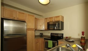 Kitchen appliances include range, refrigerator, dishwasher, and microwave  Residences at Manchester Place