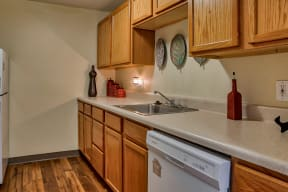 Kitchen appliances include range, refrigerator, dishwasher, and garbage disposal| The Boulders
