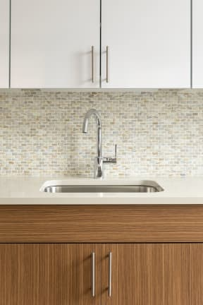 kitchen sink with tile backsplash | The Merc apartments