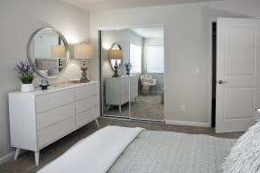 Large bedroom with mirror wardrobe doors
