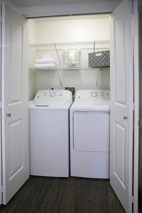 Full sized washer dryers in each apartment