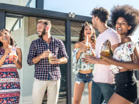 a group of young adults drinking and having fun outside