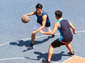 People playing basketball on a court