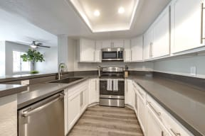 Apartments for Rent in San Clemente, CA - Rancho Del Mar Kitchen with Stainless Steel Appliances, and Modern White Wood Cabinets