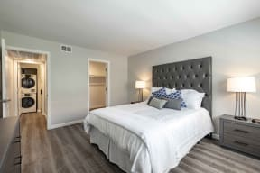 Rancho Del Mar Apartments in San Clemente, CA with Hardwood Floors, Closet, White Walls, and Access to the Bathroom