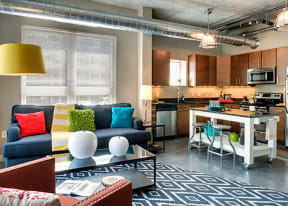 Be @ The Calhoun Greenway Apartment Kitchen and Living Area with Kitchen Island and Couches