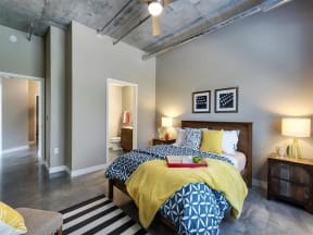 Be @ The Calhoun Greenway Apartment Bedroom with Bathroom Entrance and Concrete Floor