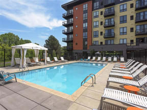 Be @ The Calhoun Greenway Blue Pool with Poolside Chairs and Cabana