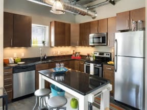 Be @ The Calhoun Greenway Apartment Kitchen with Kitchen Island, Refrigerator, Oven, Dishwasher, Microwave and Sink