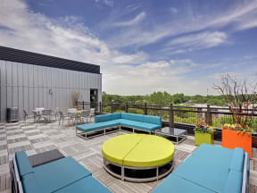 Be @ The Calhoun Greenway Rooftop Patio and Sitting Area with couches, chairs, and tables