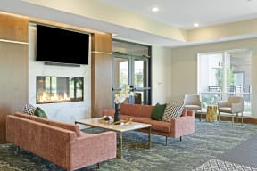 Fireside lounge at Nuvelo at Parkside Apartments in Apple Valley