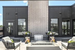 Outdoor firepit and rooftop lounge - Nuvelo at Parkside Apartments