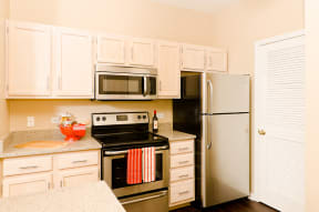 Ovaltine Court Kitchen with Modern Cabinetry, Granite Countertops, Stainless Steel Applicances