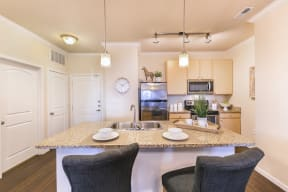 Island Kitchens w Bar Stool Seating at Aventura at Forest Park, St. Louis, 63110