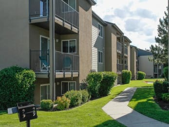 Lush Green Courtyard With Walking Paths at Crossroads Apartments, West Valley, UT, 84119