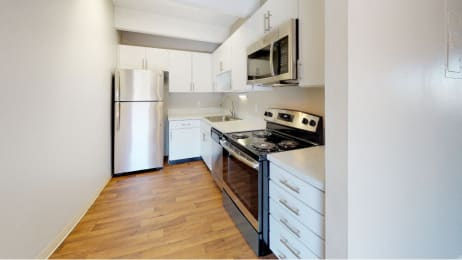 Upgraded stainless steel appliances, quartz countertops, and new cabinets
