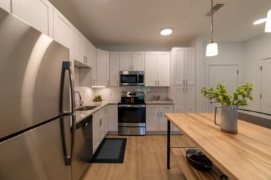 Fully Equipped Kitchen Includes Frost-Free Refrigerator, Electric Range, & Dishwasher at The Approach at Summit Park, Ohio, 45242
