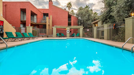 El Dorado Area large sparkling pool with lounge chairs.