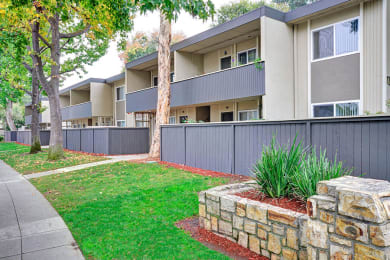 exterior shot of private balconies and patios at Trestles Apartments in San Jose, CA
