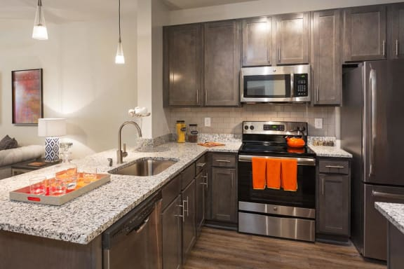 Kitchens with Upgraded Finishes at The Gentry at Hurstbourne, Louisville, 40222