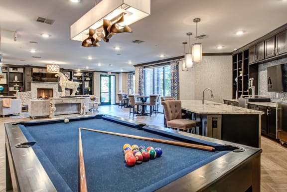 billiards table in large game room