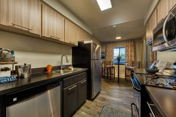 Apartments in Scottsdale for Rent - Denim Scottsdale Modern Kitchen with Up-to-Date Appliances, Sleek Countertops, and Ample Cabinet Storage