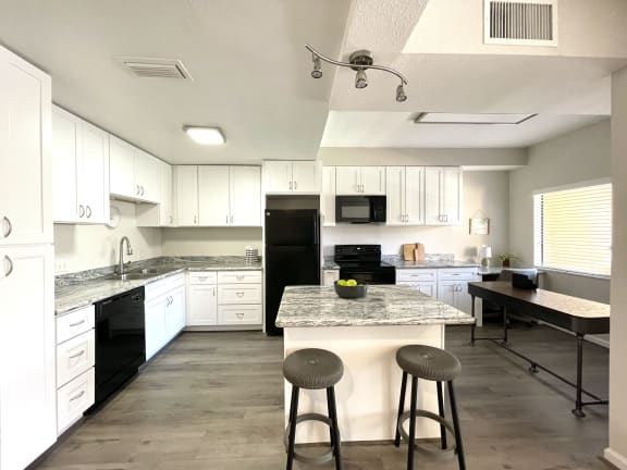 Large kitchen with island at Augusta Court Apartments in Houston Texas 77057