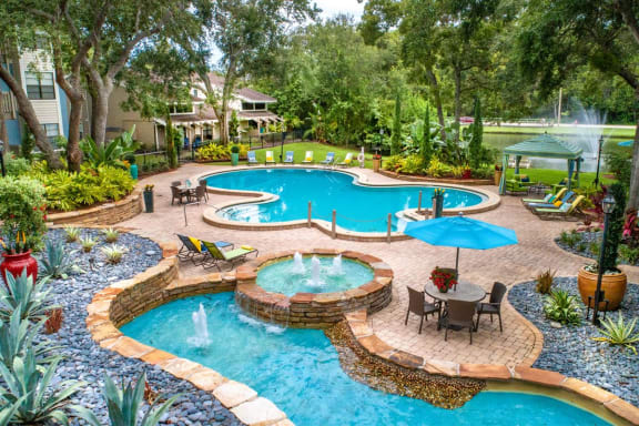 Lay by our relaxing pool with running fountains