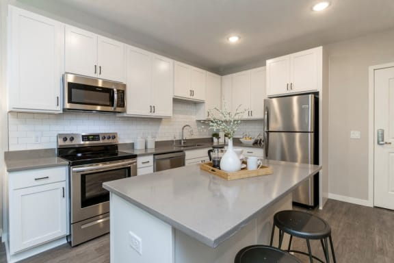 Kitchen with Island and Stools to sit and enjoy at The Barnum Apartments near White Bear Lake, MN
