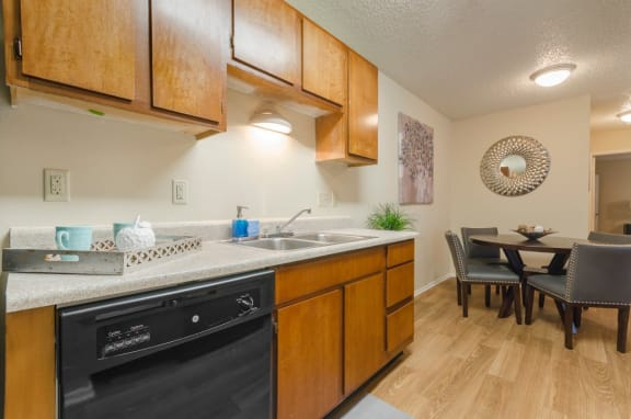 Living and dining view of Arbors of Cleburne apartment interior