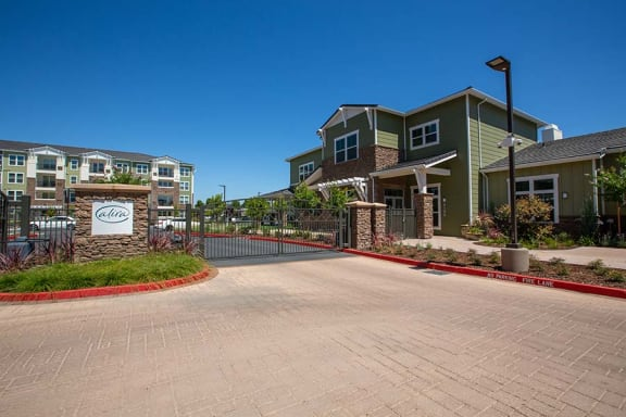Entry to community with monument signl Alira Apartments in Sacramento Ca