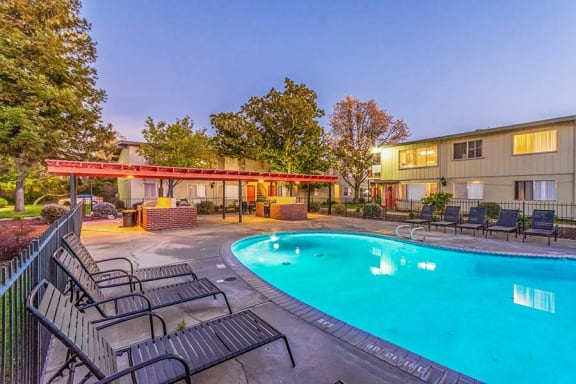 Pool with lounge chairs l Cottage Bell Apartments in Sacramento CA