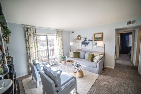 Living Room with Balcony Access at Pheasant Run, Lafayette, IN, 47909
