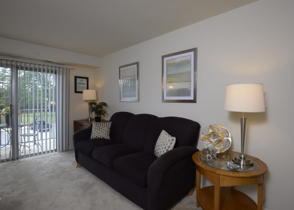 Seminary Roundtop Apartments living room with private balcony