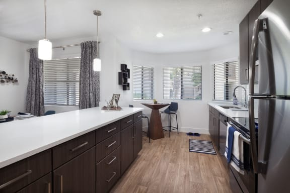 Modern Kitchen Featuring Quartz Counter Tops, Stainless Steel Appliances, And Brushed Nickel Finishes. at The Bryant at Yorba Linda, Yorba Linda, CA