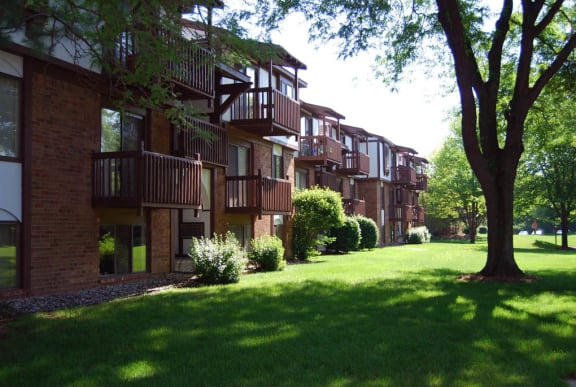 Courtyard Garden with Large Mature Trees at Granada Apartments, Michigan, 49202