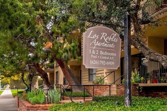 Welcoming Property Sign at Los Robles Apartments, Pasadena, California