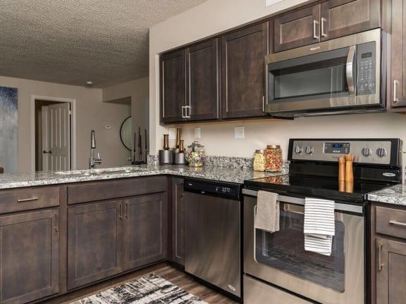 Espresso Colored Kitchen Cabinetry at Fairlane Woods Apartments, Michigan