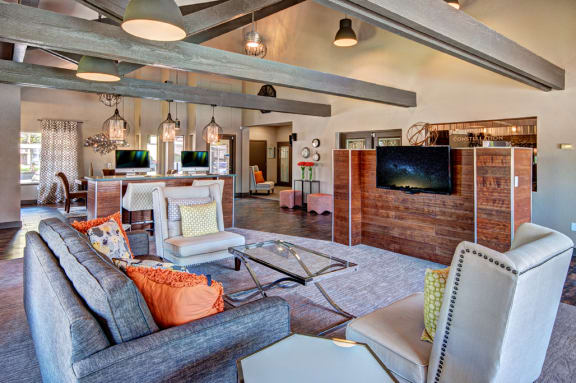 Apartments in Renton WA- Clubhouse With Plush Seating Area, Flatscreen TV, and Modern Finishes