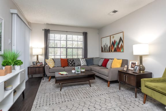 Living Room With Expansive Window at Peppermill Apartments, CLEAR Property Management,Texas, 78148