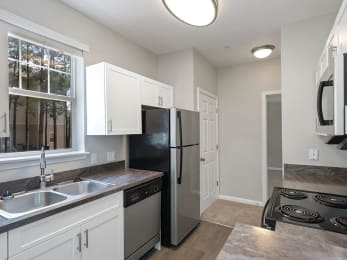 Kitchen sink and window at Falls Pointe Apartments in Durham NC