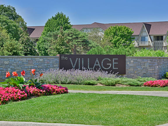 Entrance Sign and Garden at The Village Apartments, Wixom, MI