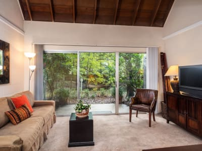 living room with lots of natural light and carpeted floors
