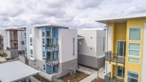 Dog Friendly Apartments in Folsom CA - Hub Apartments - Exterior of Apartment Building With Outdoor Patio and Balcony