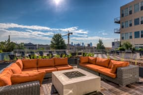Outdoor Lounge Area with Fire Pit - 2828 Zuni Apartments