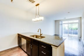 Kitchen island and balcony view - Apartments at 2828 Zuni
