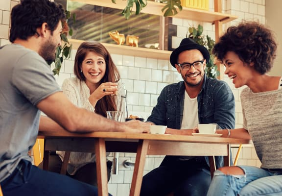 Four people enjoying coffee together