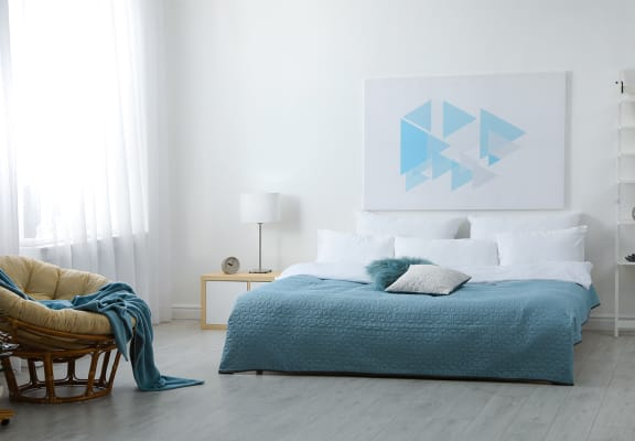 Bedroom with modern blue accents
