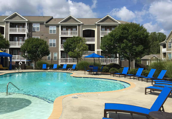 Resort style pool with sundeck and apartment exterior